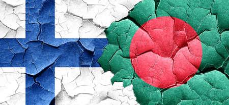 bangladesh: finland flag with Bangladesh flag on a grunge cracked wall