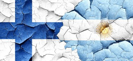 finland flag: finland flag with Argentine flag on a grunge cracked wall