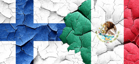FINLAND flag: finland flag with Mexico flag on a grunge cracked wall