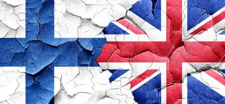 england politics: finland flag with Great Britain flag on a grunge cracked wall Stock Photo