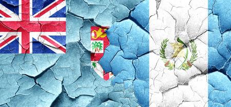 bandera de guatemala: bandera de Fiji con el indicador de Guatemala en una pared agrietada grunge Foto de archivo