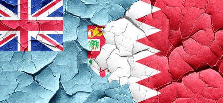 cracked wall: Fiji flag with Bahrain flag on a grunge cracked wall