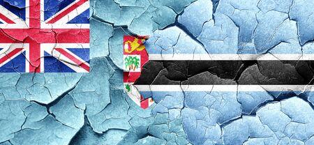 cracked wall: Fiji flag with Botswana flag on a grunge cracked wall