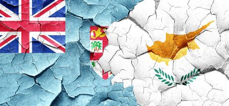 cracked wall: Fiji flag with Cyprus flag on a grunge cracked wall Stock Photo