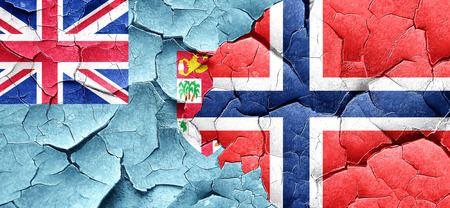 fiji: Fiji flag with Norway flag on a grunge cracked wall Stock Photo