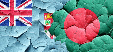 bangladesh: Fiji flag with Bangladesh flag on a grunge cracked wall