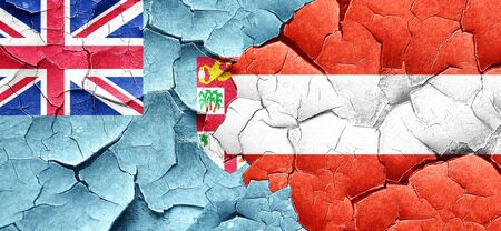 cracked wall: Fiji flag with Austria flag on a grunge cracked wall
