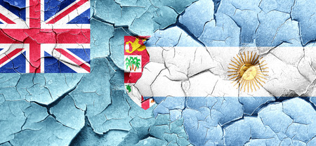 argentine: Fiji flag with Argentine flag on a grunge cracked wall Stock Photo