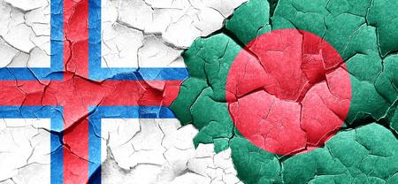 bangladesh: faroe islands flag with Bangladesh flag on a grunge cracked wall