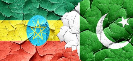pakistan flag: Ethiopia flag with Pakistan flag on a grunge cracked wall