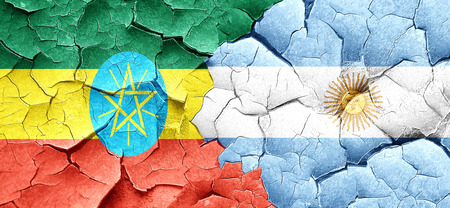 cracked wall: Ethiopia flag with Argentine flag on a grunge cracked wall Stock Photo