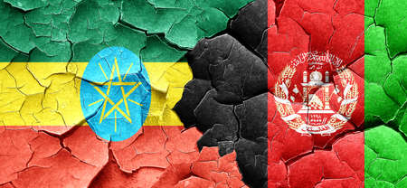 ethiopia  flag: Ethiopia flag with afghanistan flag on a grunge cracked wall
