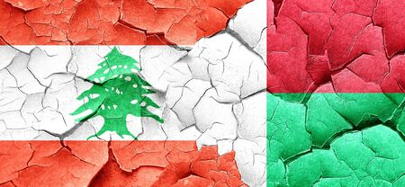 lebanon: Lebanon flag with Madagascar flag on a grunge cracked wall
