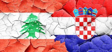 croatia flag: Lebanon flag with Croatia flag on a grunge cracked wall