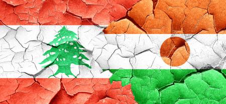 lebanon: Lebanon flag with Niger flag on a grunge cracked wall