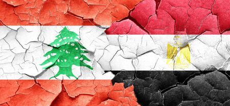 lebanese: Lebanon flag with egypt flag on a grunge cracked wall