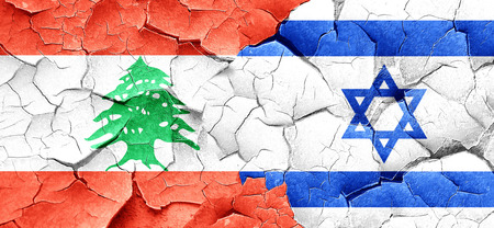 lebanese: Lebanon flag with Israel flag on a grunge cracked wall