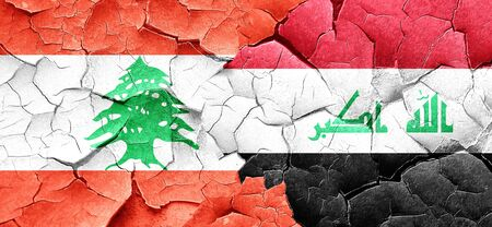 iraq conflict: Lebanon flag with Iraq flag on a grunge cracked wall