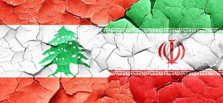 lebanese: Lebanon flag with Iran flag on a grunge cracked wall