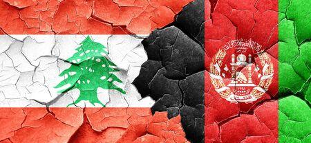Lebanon flag with afghanistan flag on a grunge cracked wall