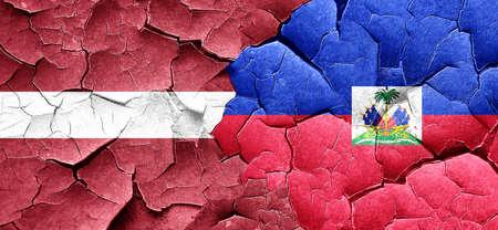 latvia flag: Latvia flag with Haiti flag on a grunge cracked wall Stock Photo