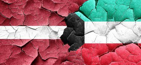 cracked wall: Latvia flag with Kuwait flag on a grunge cracked wall Stock Photo