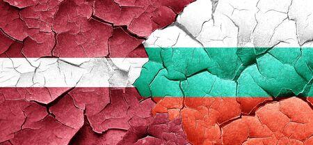cracked wall: Latvia flag with Bulgaria flag on a grunge cracked wall