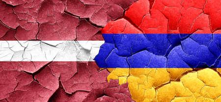 cracked wall: Latvia flag with Armenia flag on a grunge cracked wall