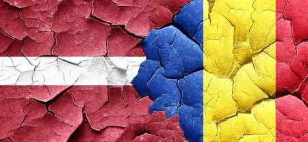 latvia flag: Latvia flag with Romania flag on a grunge cracked wall Stock Photo