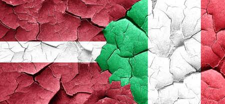 latvia flag: Latvia flag with Italy flag on a grunge cracked wall Stock Photo