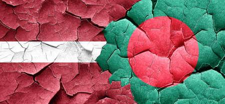 latvia flag: Latvia flag with Bangladesh flag on a grunge cracked wall Stock Photo