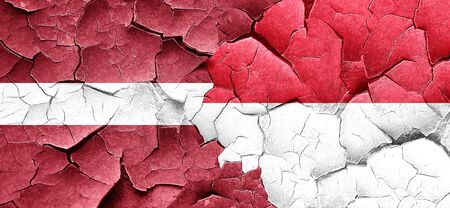 cracked wall: Latvia flag with Indonesia flag on a grunge cracked wall