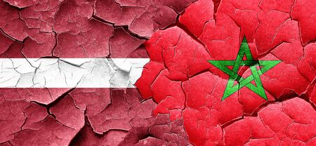 latvia flag: Latvia flag with Morocco flag on a grunge cracked wall Stock Photo