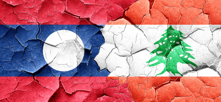 cracked wall: Laos flag with Lebanon flag on a grunge cracked wall