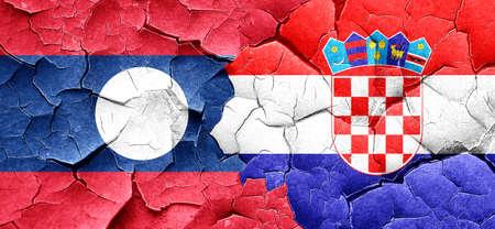 bandera croacia: bandera de Laos con la bandera de Croacia en una pared agrietada grunge