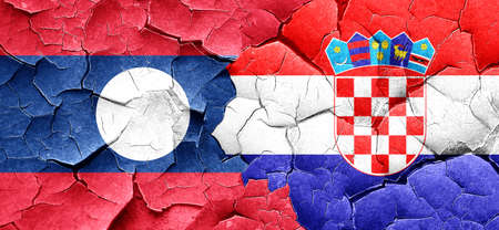 cracked wall: Laos flag with Croatia flag on a grunge cracked wall