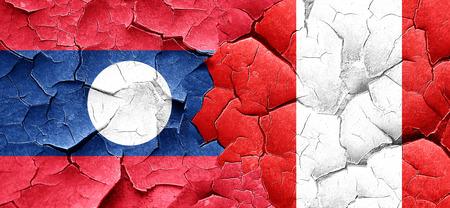 bandera peru: bandera de Laos con la bandera de Per� en una pared agrietada grunge Foto de archivo