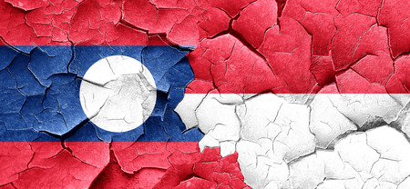 cracked wall: Laos flag with Indonesia flag on a grunge cracked wall