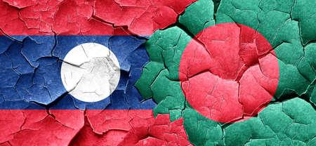 bangladesh: Laos flag with Bangladesh flag on a grunge cracked wall