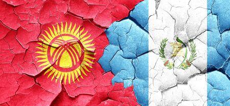 bandera de guatemala: Bandera de Kirguist�n con la bandera de Guatemala en una pared agrietada grunge