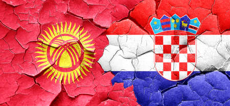 bandera croacia: Kyrgyzstan flag with Croatia flag on a grunge cracked wall Foto de archivo