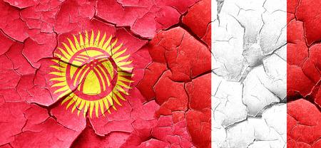 bandera de peru: Bandera de Kirguistán con la bandera de Perú en una pared agrietada grunge