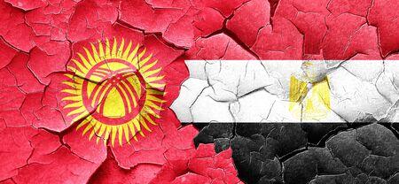 egypt flag: Kyrgyzstan flag with egypt flag on a grunge cracked wall