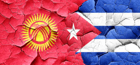 cuba flag: Kyrgyzstan flag with cuba flag on a grunge cracked wall