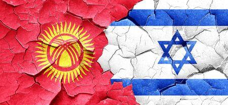 israel flag: Kyrgyzstan flag with Israel flag on a grunge cracked wall