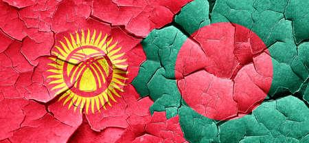 bangladesh: Kyrgyzstan flag with Bangladesh flag on a grunge cracked wall