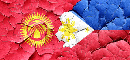 philippino: Kyrgyzstan flag with Philippines flag on a grunge cracked wall