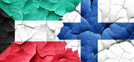 FINLAND flag: Kuwait flag with Finland flag on a grunge cracked wall