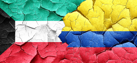 bandera de colombia: Kuwait flag with Colombia flag on a grunge cracked wall Foto de archivo