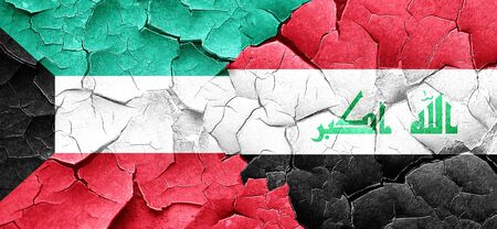 iraq conflict: Kuwait flag with Iraq flag on a grunge cracked wall